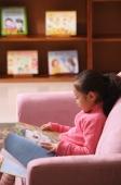 Young girl reading a book - Alex Mares-Manton