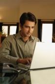 man working at laptop - Alex Mares-Manton