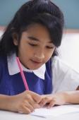 girl concentrates on schoolwork - Alex Mares-Manton