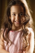 little girl with long hair smiles at camera - Alex Mares-Manton