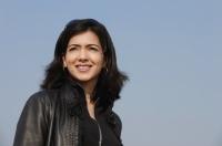 woman smiling in leather jacket (horizontal) - Alex Mares-Manton
