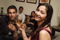 couple at party, woman looking at camera, guy looking at woman - Alex Mares-Manton