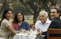 family having meal outdoors - Manoj Adhikari