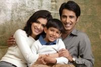 family of three smiling at camera (horizontal) - Alex Mares-Manton