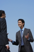 two business colleagues laughing - Alex Mares-Manton