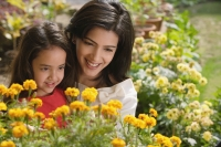 mother and daughter look at flowers - Alex Mares-Manton