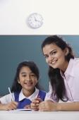 teacher and student smile at camera (close up) - Alex Mares-Manton