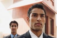 two business men, facing camera (close up) - Alex Mares-Manton