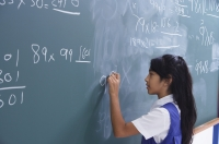 girl working at chalkboard (horizontal) - Alex Mares-Manton