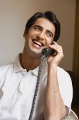 man laughs while talking on phone - Alex Mares-Manton