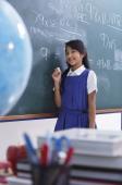 girl at chalkboard smiling - Alex Mares-Manton