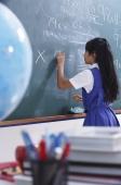 girl working at chalkboard (vertical) - Alex Mares-Manton