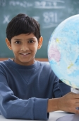 boy holding globe, gray sweatshirt - Alex Mares-Manton