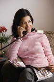 woman talks on phone (vertical) - Alex Mares-Manton