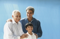Grandfather, father, son smiling at camera - Manoj Adhikari