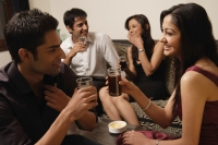 two couples talking at a party - Alex Mares-Manton