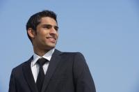 businessman smiles, looks back - Alex Mares-Manton