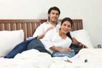 Couple in bed - Deepak Budhraja