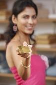 lady holding gold card - Vivek Sharma