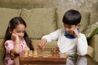 boy and girl play chess - Alex Mares-Manton