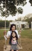 mother with girl on swing - Manoj Adhikari