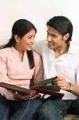 Husband and wife reading book - Deepak Budhraja