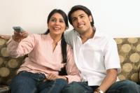 Husband and wife watching tv - Deepak Budhraja