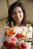 woman smiles holding bouquet of flowers - Alex Mares-Manton