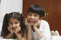 Brother and sister on bed - Manoj Adhikari