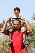 Father with son on his shoulders - Deepak Budhraja