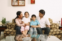 Family on couch - Deepak Budhraja
