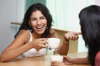 two young woman having coffee - Vivek Sharma