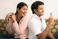 Husband and wife playing cards - Deepak Budhraja