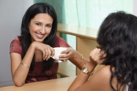 two young woman having coffee - Vivek Sharma