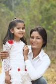 Mother with arms around daughter - Manoj Adhikari