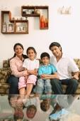 Family sitting on couch - Deepak Budhraja