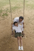 father and son in swing - Manoj Adhikari