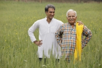 father and son farmers in field - Manoj Adhikari