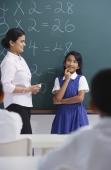 teacher and girl at chalkboard - Alex Mares-Manton
