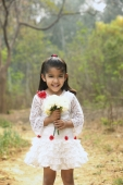 Little girl in white dress holding bouquet (vertical) - Manoj Adhikari