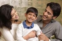 parents smile proudly at their son, son smiles at camera - Alex Mares-Manton