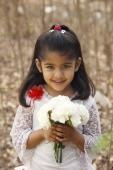 Little girl in white dress holding bouquet (portrait) - Manoj Adhikari