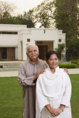 senior couple in front of home - Manoj Adhikari