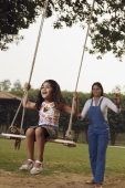 mom pushing daughter in swing - Manoj Adhikari