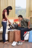 woman showing boyfriend shopping - Vivek Sharma