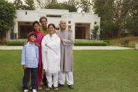 family in front of home - Manoj Adhikari