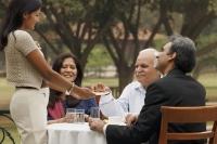 family having meal outdoors - Manoj Adhikari