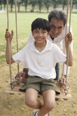 father with son on swing - Manoj Adhikari