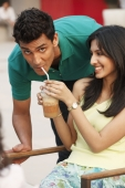 girlfriend sharing drink with boyfriend - Vivek Sharma