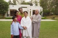 family in front of home - Manoj Adhikari
